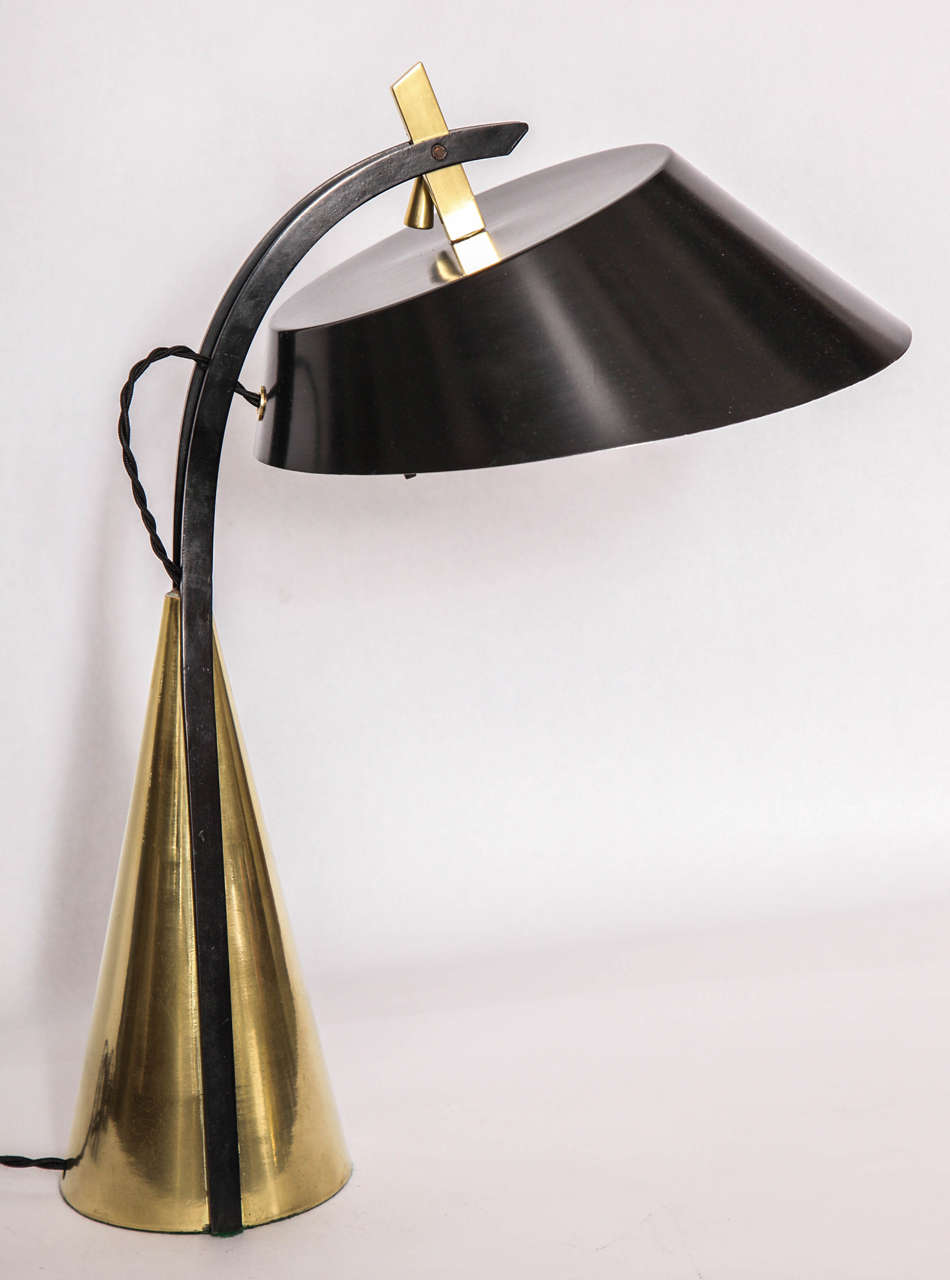 A 1950s articulated table lamp. Shades adjusts.