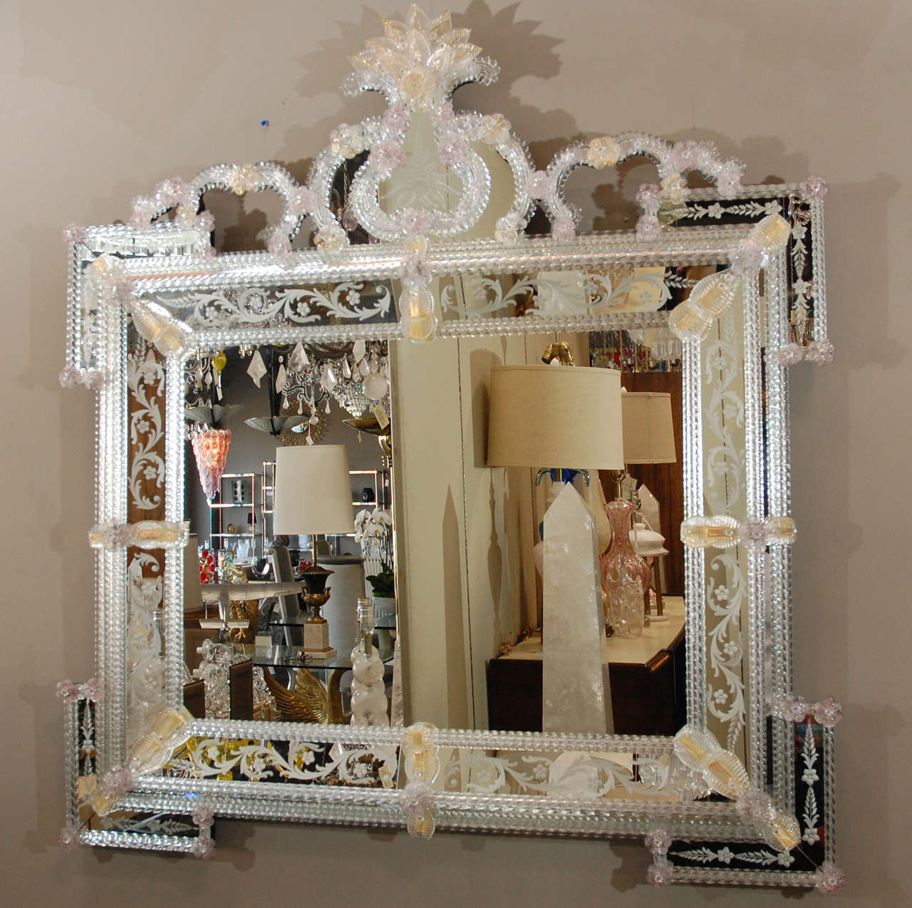 Traditional delicate reversed etched Venetian landscape mirror. Each leaf and flower is hand blown and attached separately to the frame. Recognized by Vetro Artistico Murano (sticker on the front of the glass)