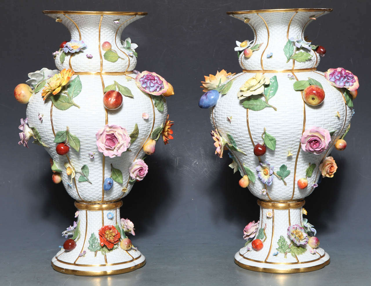 A monumental pair of 19th century Meissen Porcelain vases of exceptional quality. These Vases show one of Meissen's signature motifs, the realistically modeled fruits and flowers (raised on a basket weave background), to great advantage. The apples