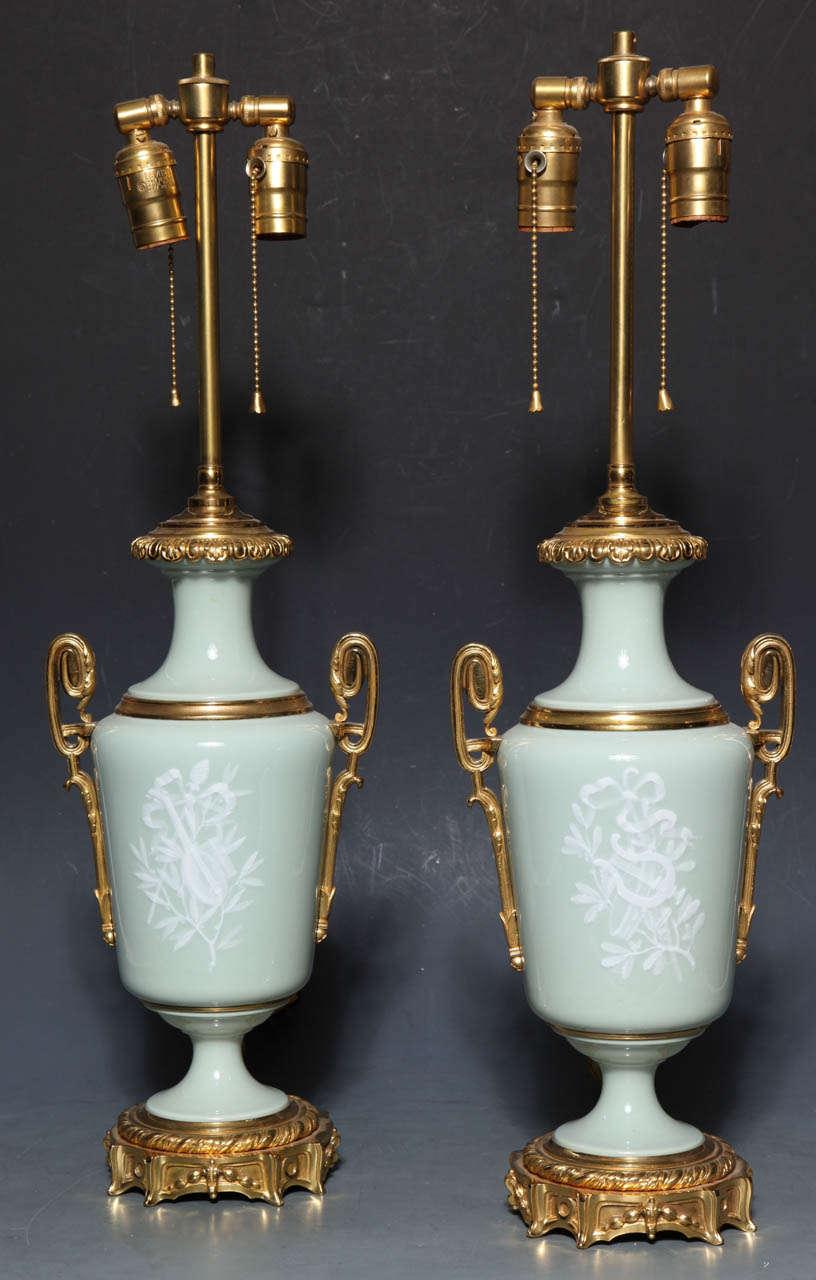 Neoclassical Revival Pair Ormolu Mounted 'Pate sur Pate' Porcelain Lamps Depicting Cupids For Sale
