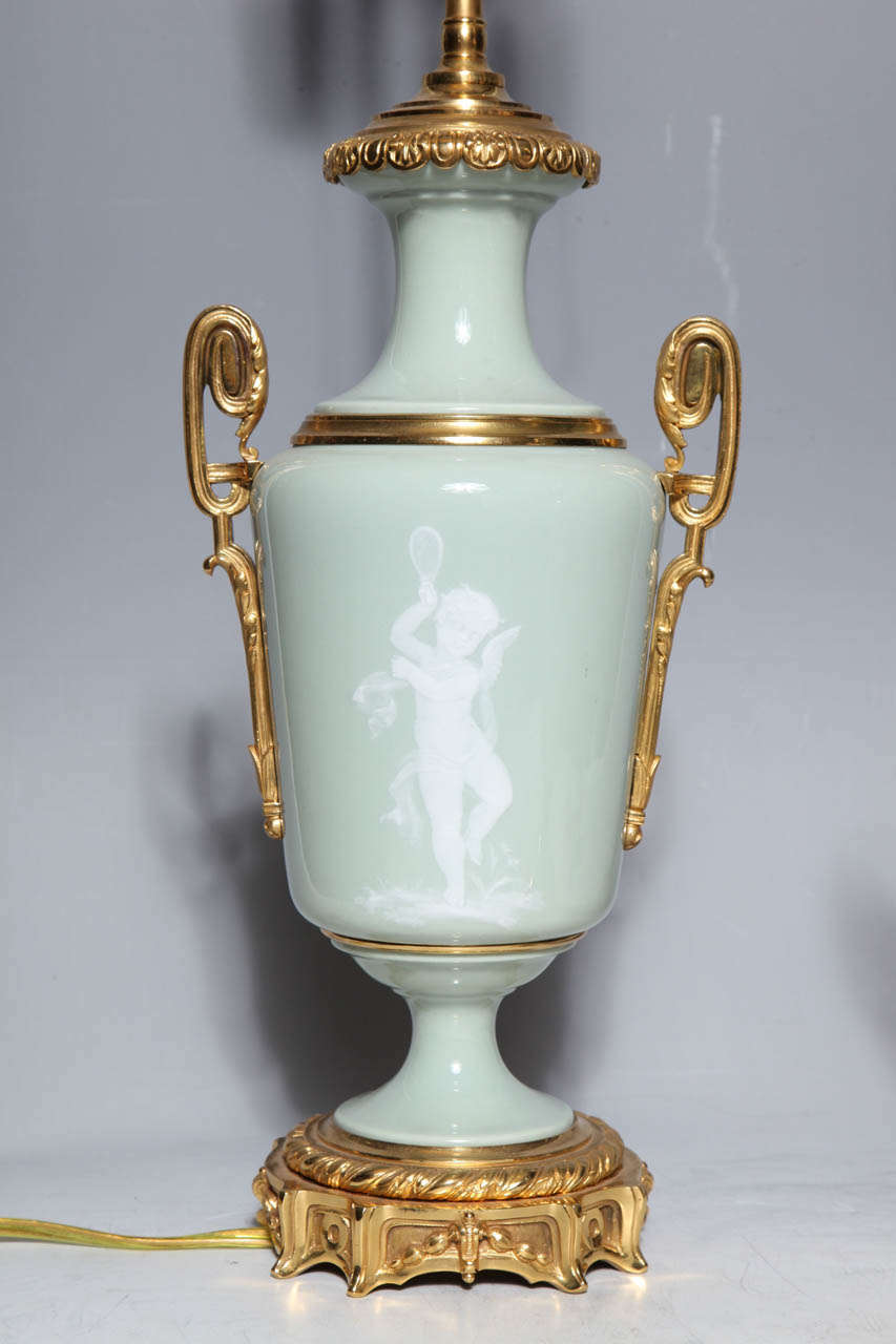 Pair Ormolu Mounted 'Pate sur Pate' Porcelain Lamps Depicting Cupids In Excellent Condition For Sale In New York, NY