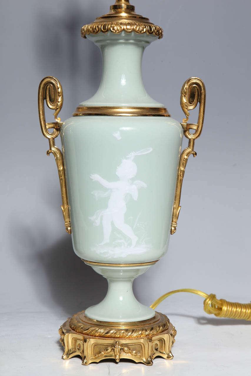 19th Century Pair Ormolu Mounted 'Pate sur Pate' Porcelain Lamps Depicting Cupids For Sale