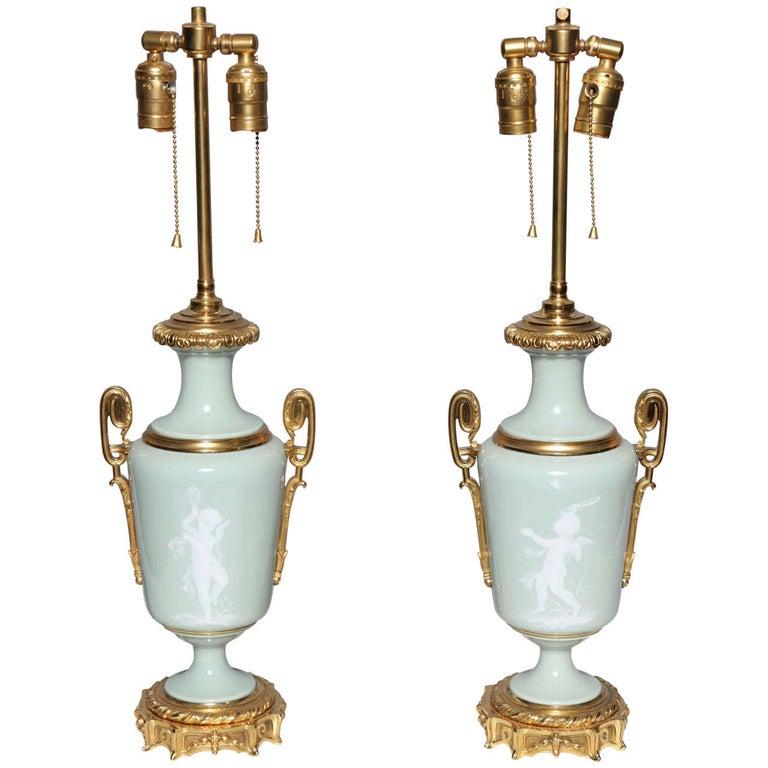Pair Ormolu Mounted 'Pate sur Pate' Porcelain Lamps Depicting Cupids For Sale
