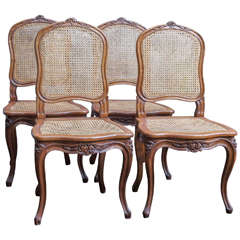 Eight French Walnut and Cane Dining Chairs, circa 1900