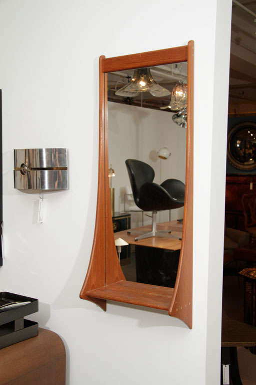Teak wall mirror with shelf.  Denmark, circa 1960.  Beautifully joinery detailing.  Signed with maker's stamp on back.
