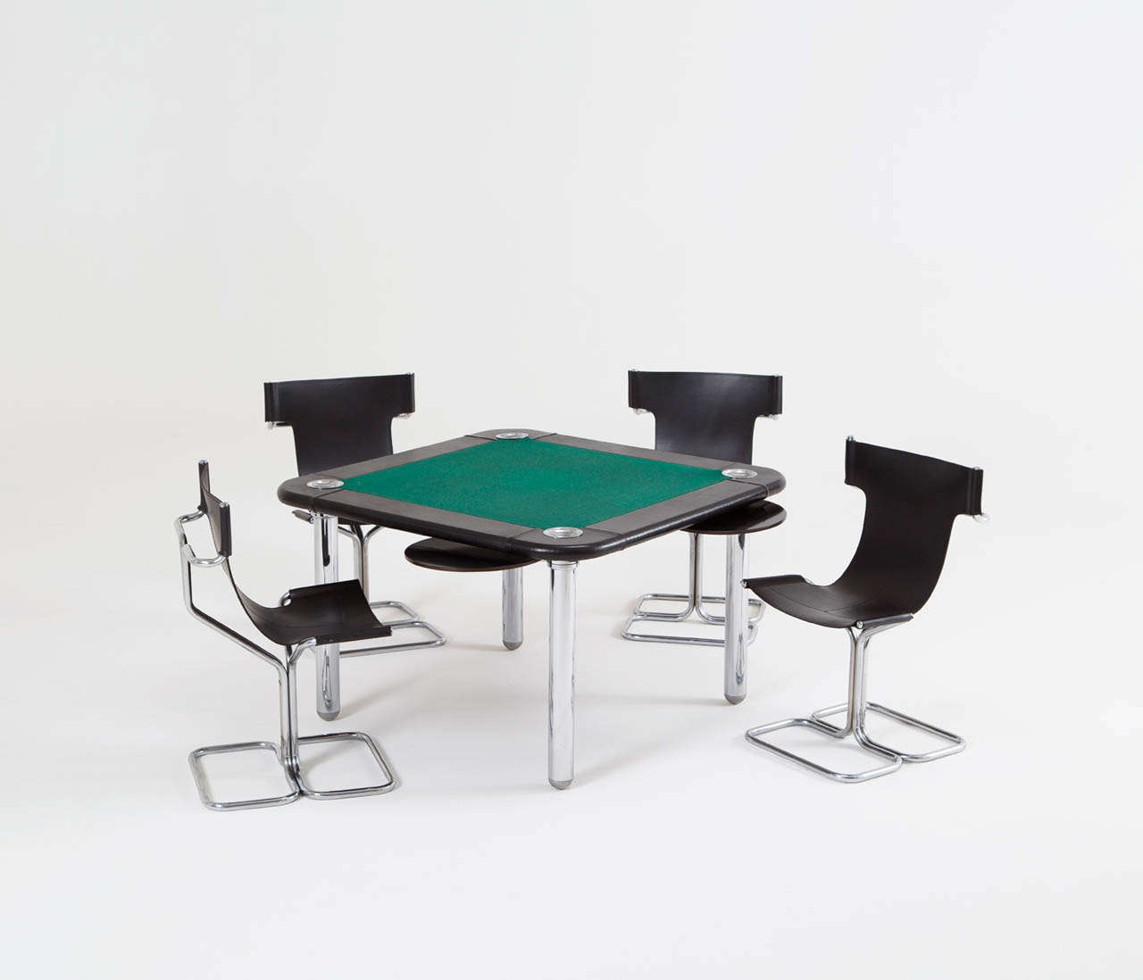 Excellent gaming table in chrome and leather finish. The table has a green gaming cloth with leather edges with four stainless steel bowls for gaming chips, and chromed tubular legs.  The four chairs are also in original condition in leather with