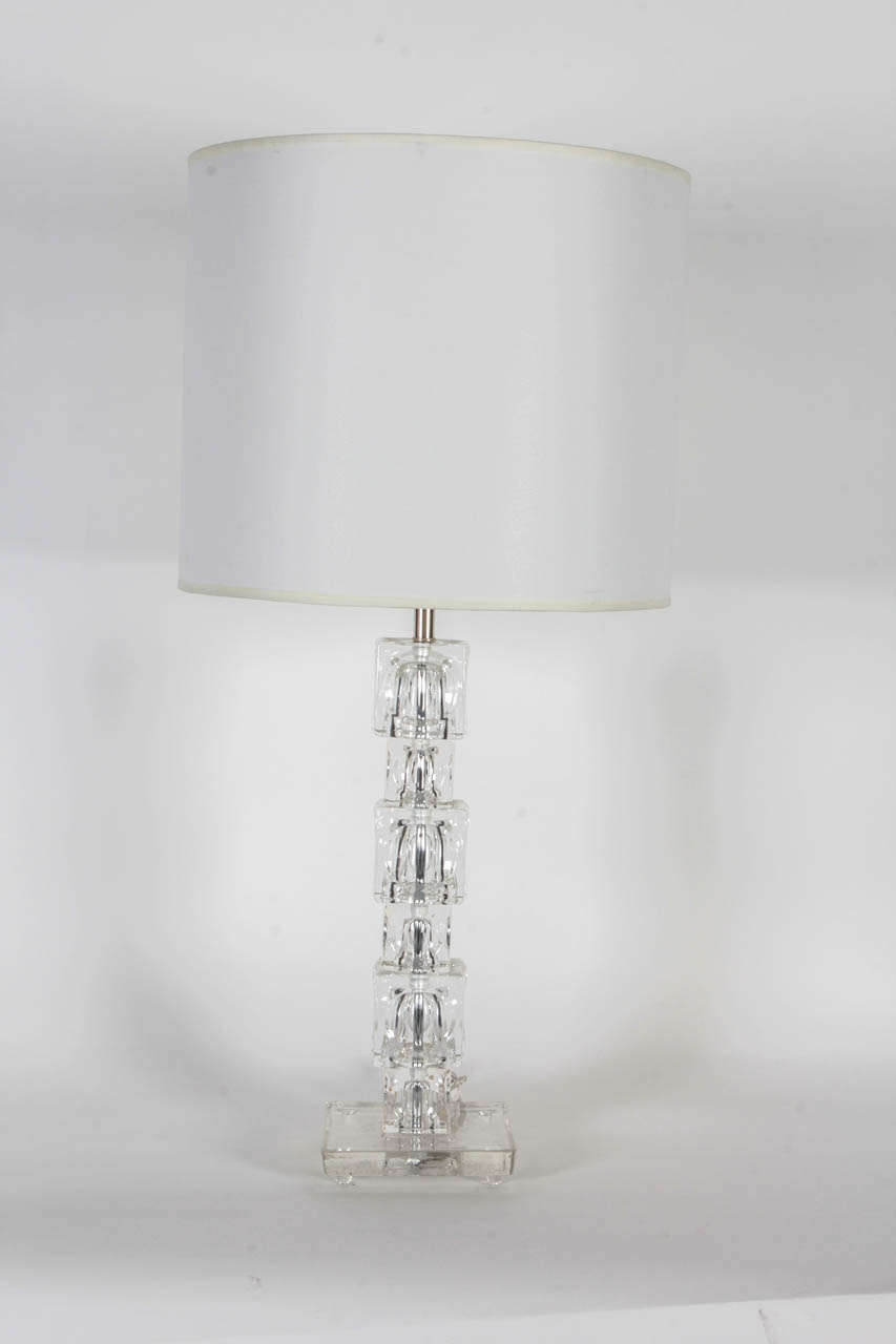 Fantastic pair of stacked crystal block lamps with concave sides and resting on a crystal base.