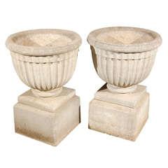 Pair of Ribbed Granite Urns