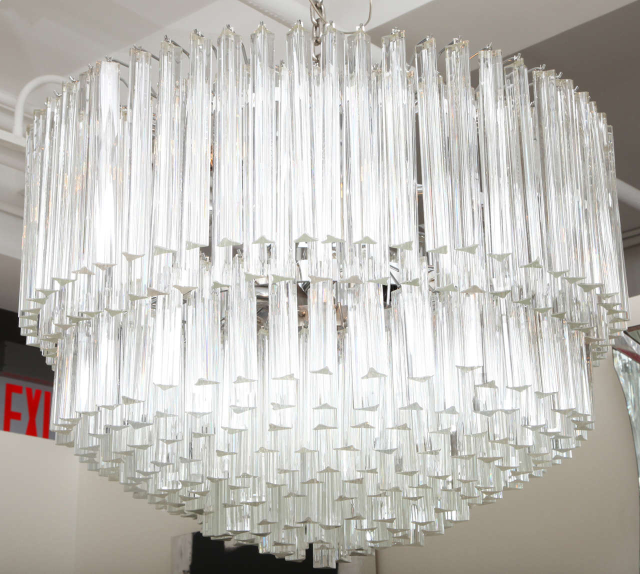 "A unique and magnificent Murano glass chandelier in the style of Camer. 36"" diameter. Comprised of  individually hand blown Murano glass triangular (triede) crystal prisms on a chrome frame, this large mid century Italian chandelier is truly a"