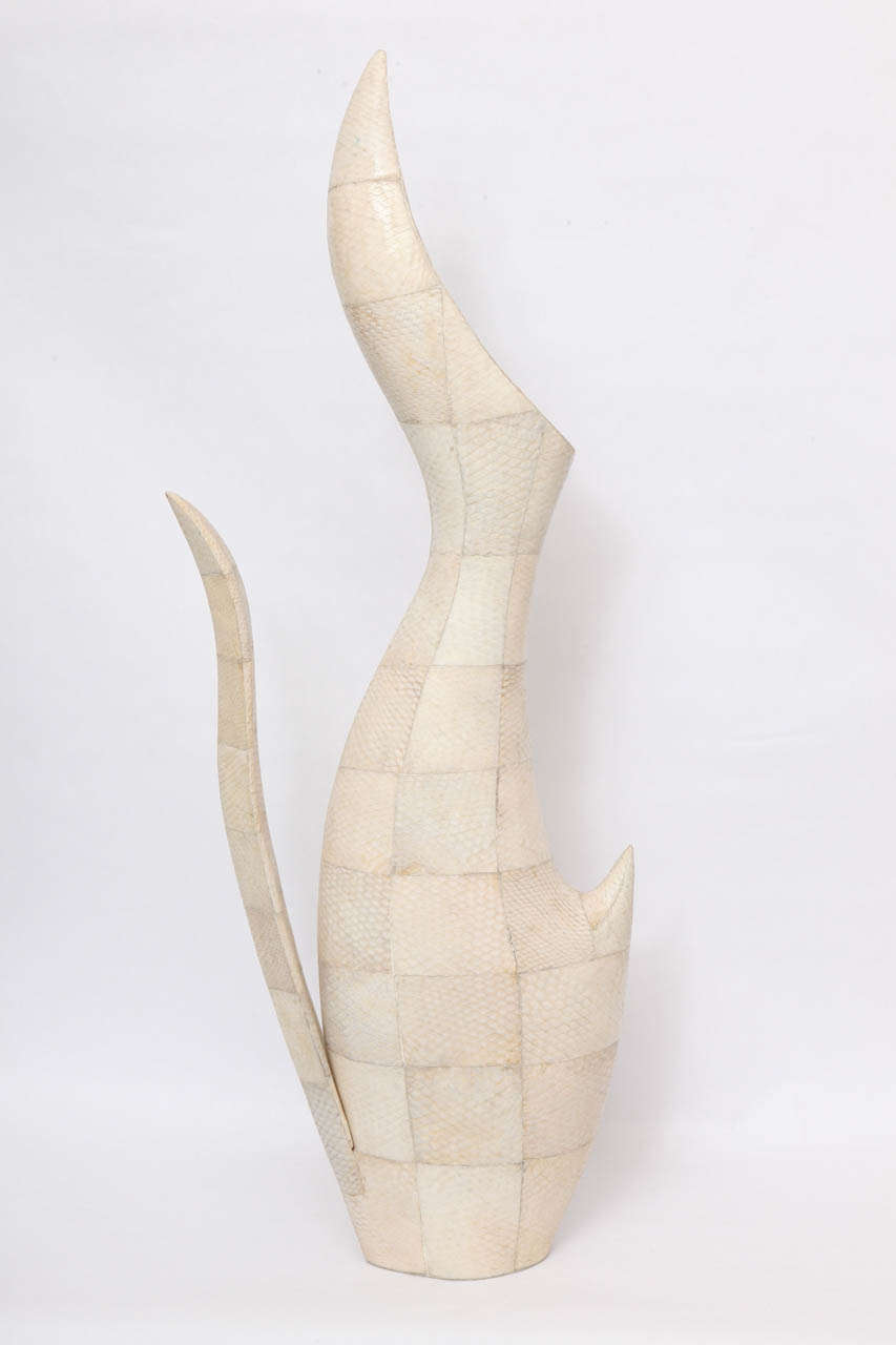 A 1970s sculptural vase of snakeskin.