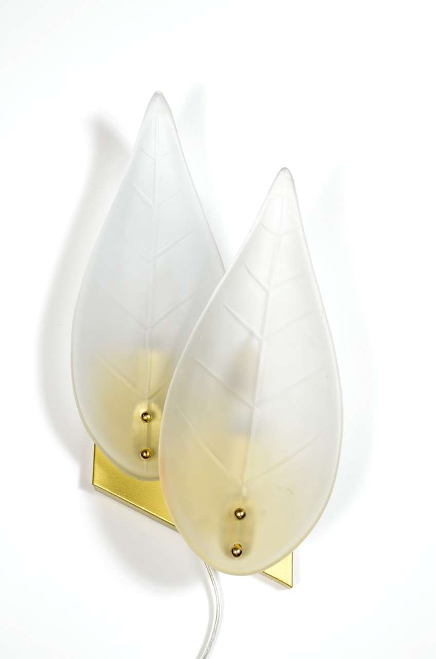 This pair of Mid-Century sconces have a frosted glass double leaf design mounted on gilt fittings with brass details. Each sconce holds two bulbs and has been completely re-wired to American standards. Excellent condition.