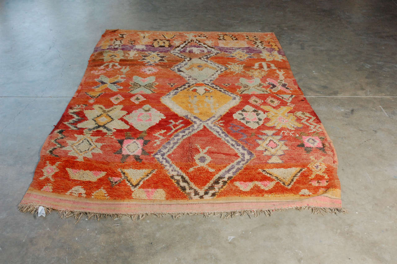 Crafted by women in the interior plains and mountains on fixed-heddle looms, Moroccan rugs can vary greatly depending on the tribes that weave them. Nonetheless, they all use severely geometric Moroccan decoration, sometimes in muted tones,