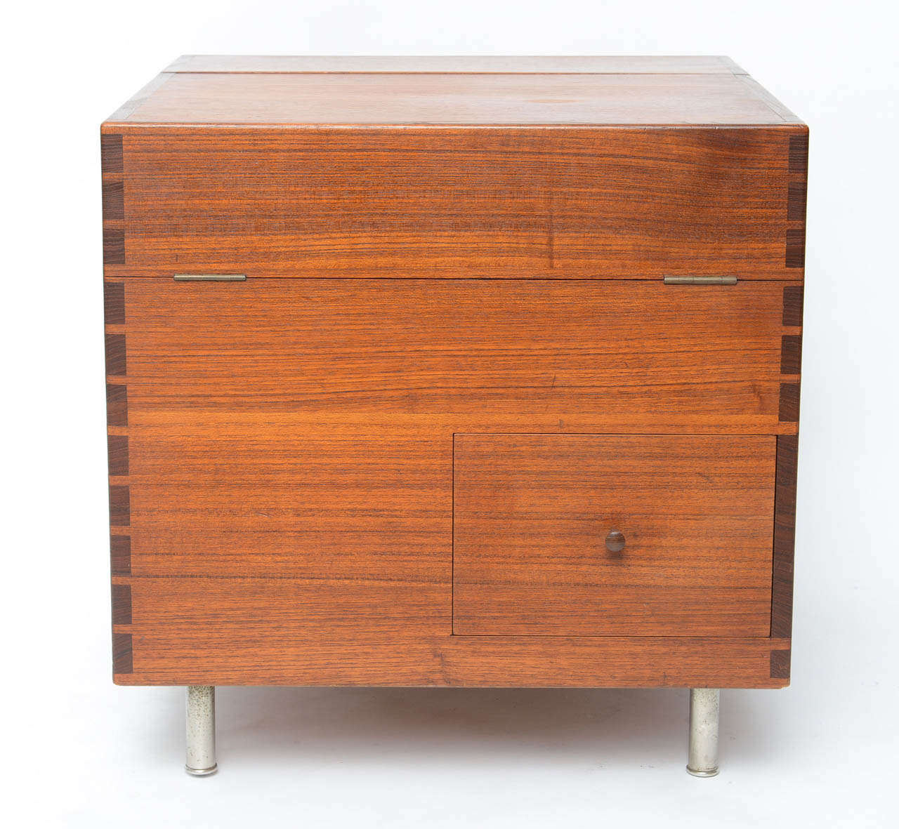 Rare and great design by Hans Wegner. Bar features one drawer and a hinged top concealing storage. Signed with branded manufacturer's mark to underside.