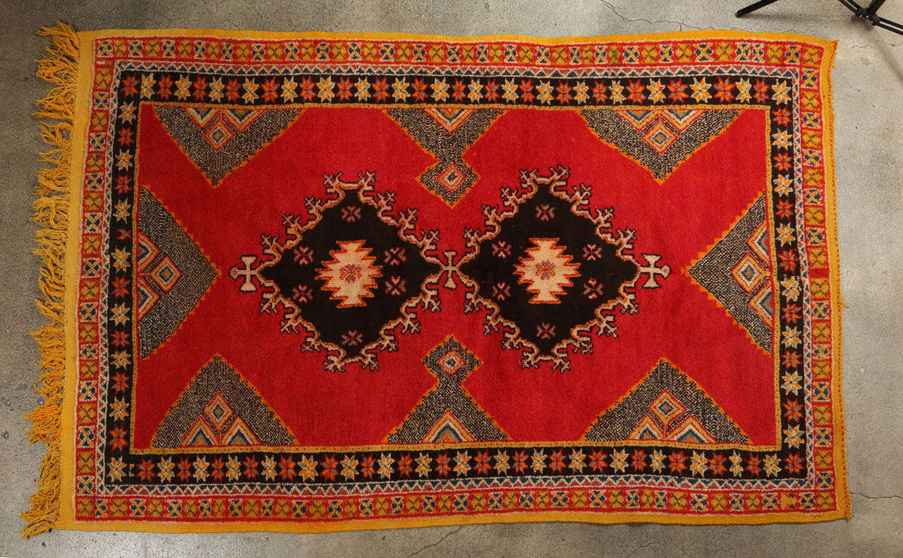 Vintage Moroccan Berber rug from the Taznakht tribe in south eastern Morocco.  Rare piece with beautiful color combination in organic dyes and lamb wool. Wonderful work of Art, oranges geometrical design, free style, amazing vintage Moroccan