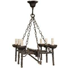 A  French Wrought Iron Six Light Chandelier
