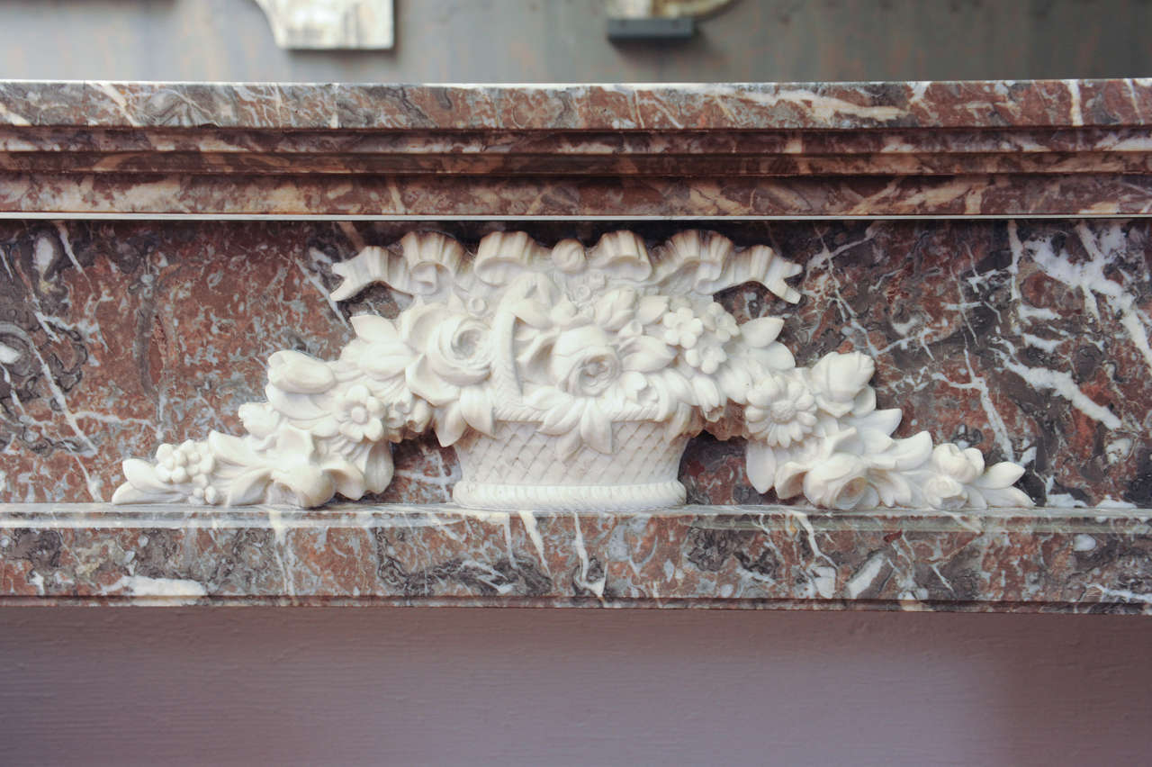 An early 19th century French Neoclassical marble fireplace