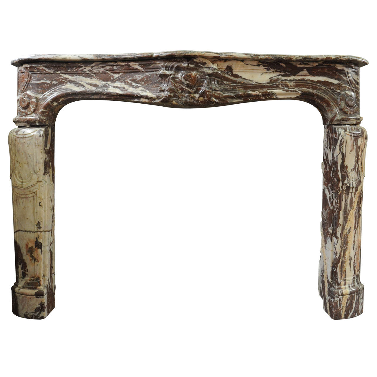 An 18th century French Louis XIV marble fireplace / mantel piece, circa 1730 1
