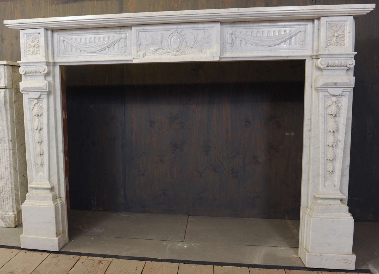 View this item and discover similar architectural elements for sale at 1stdibs - A 19th century French Carrara marble fireplace/mantlepiece in Neoclassical style