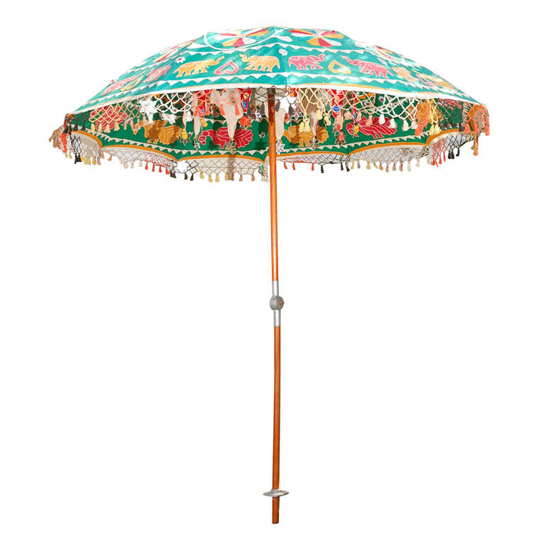 multi colored indian umbrella with mirrors and animals at