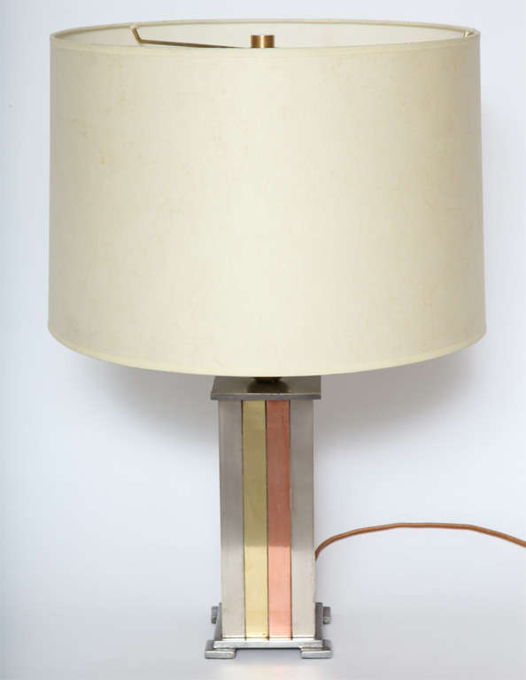 A 1930s American modernist Art Deco mixed metal table lamp. Shade not included