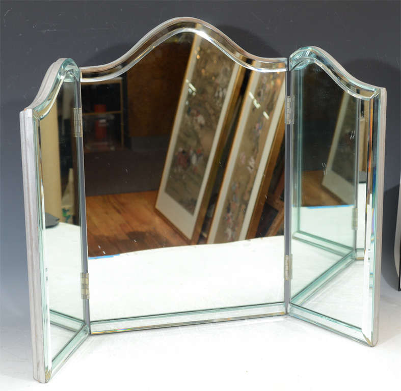 A vintage Hollywood regency folding triptych table-top vanity mirror with  silver-leafed wood - Vintage Hollywood Regency Tri-Fold Vanity Mirror At 1stdibs