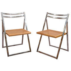 Mid Century Set of Four Folding Chrome and Cane Chairs