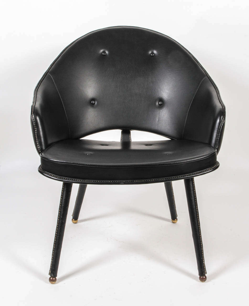 1950s stitched black leather armchair by Jacques Adnet. Leather have been changed by a worker of Hermes firm.