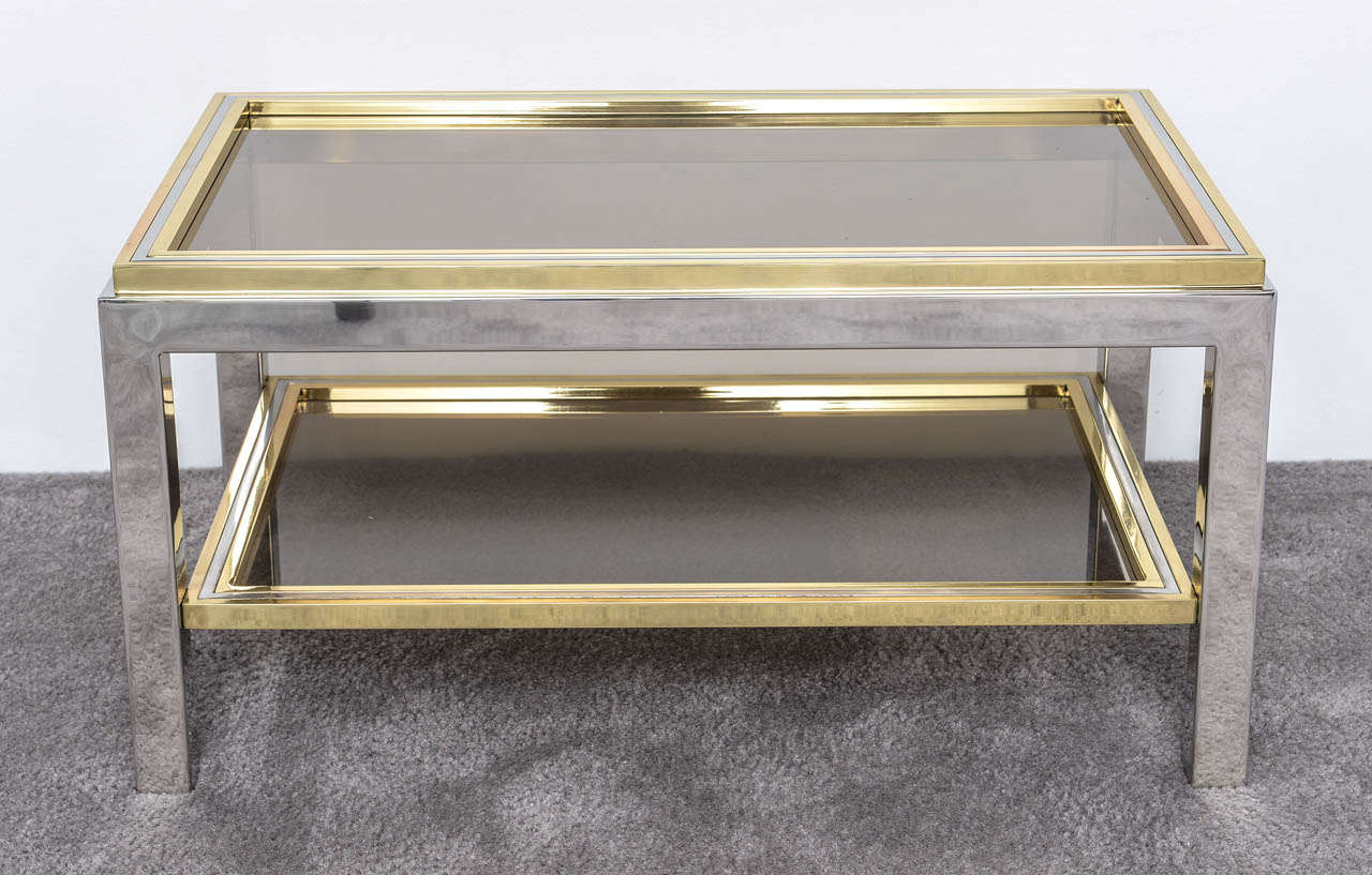Two colored metals: Brass and chrome. Two levels, very strict and elegant lines. Perfect proportions and elegant design. In the style of Romeo Rega and Willy Rizzo. Italian Mid Century .