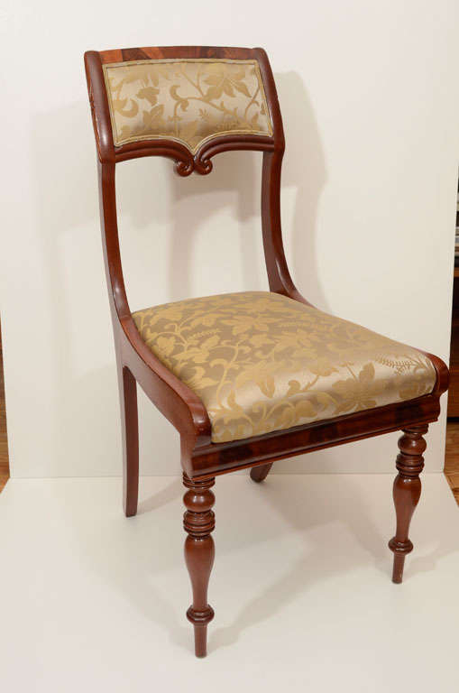 Biedermeier dining chairs in mahogany with turned and fluted legs. Set-in seat is fully cushioned and recently reupholstered in a damask fabric.