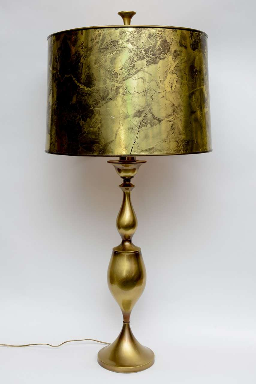 REDUCED FROM $950. Spectacular in scale and style, this tall Rembrandt brass baluster and urn form table lamp has its original marbleized foil barrel shade and large finial. Wonderfully sculptural, it makes a regal impression and is a room anchor.