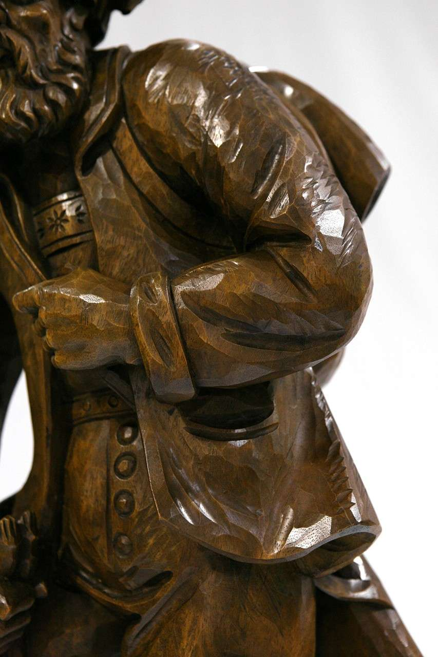 A wooden german carving of hunter with dog at stdibs