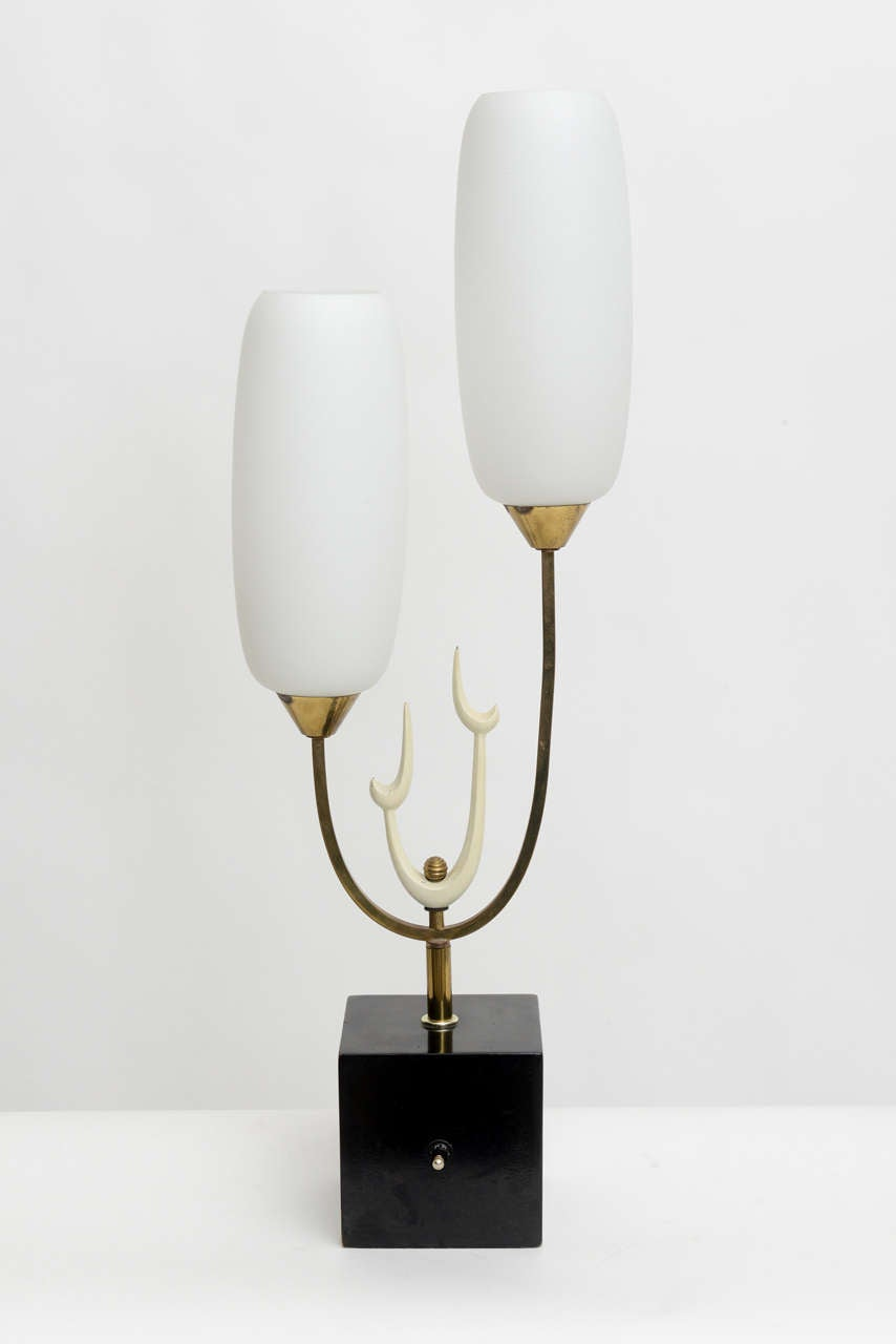 Glass lamp with frosted glass shades on a brass and enameled structure.