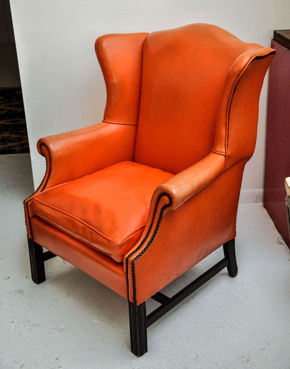 Vintage Orange Leather Wing Chair with distressed espresso wood base and  antique brass nailhead trim - Vintage Orange Leather Wing Chair At 1stdibs