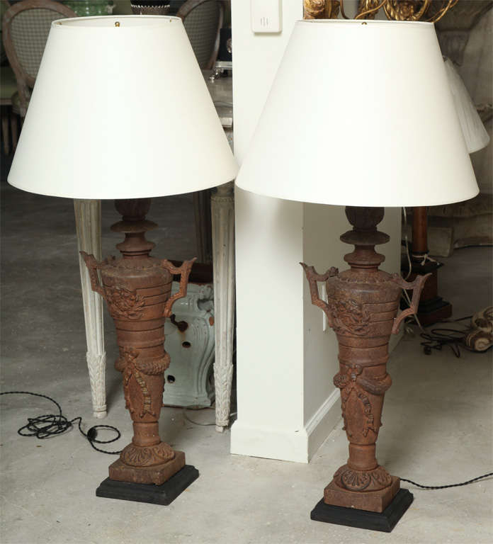 Wonderful patina on these two pairs of cast iron finial lamps.