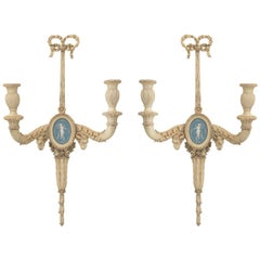 Pair of 19c. Carved Wood Sconces Centered by Wedgewood Bisque Plaques.
