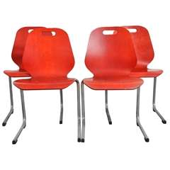 Set of 12 French Red Stacking Wood and Chrome Chairs