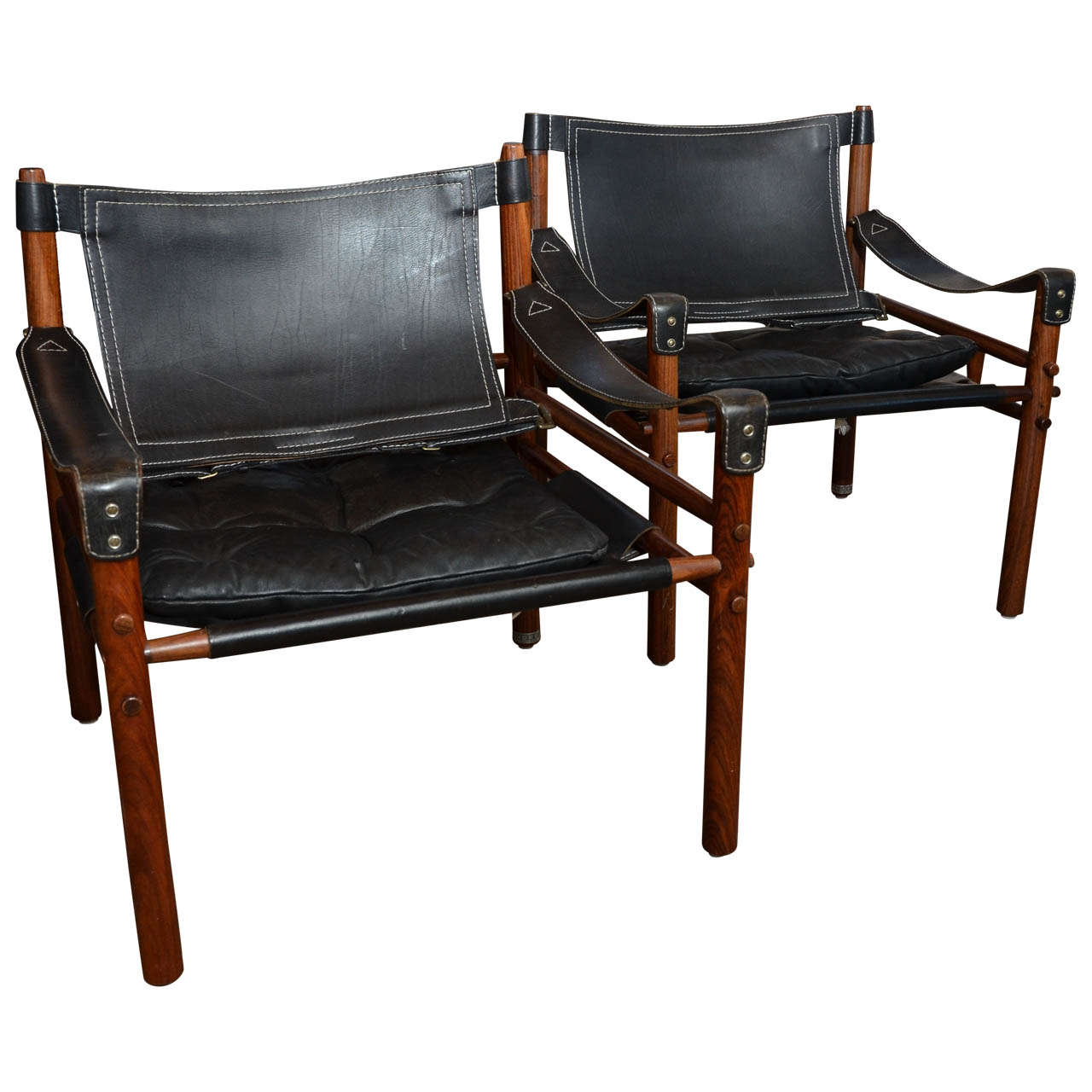 Mid Century Pair Of Arne Norell Sirocco Safari Chairs In Rosewood And Black