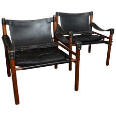 "Mid-Century Pair of Arne Norell ""Sirocco"" Safari Chairs in Rosewood and Black Leather"