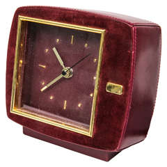 Mid-Century Leather and Suede Clock Presented by Funky Finders