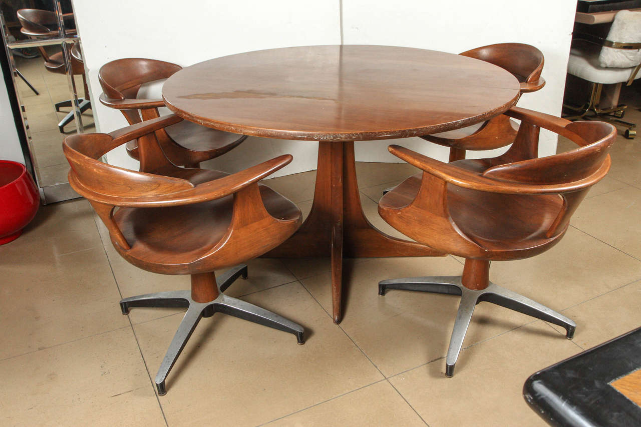 heywood wakefield dining table with four captain chairs at