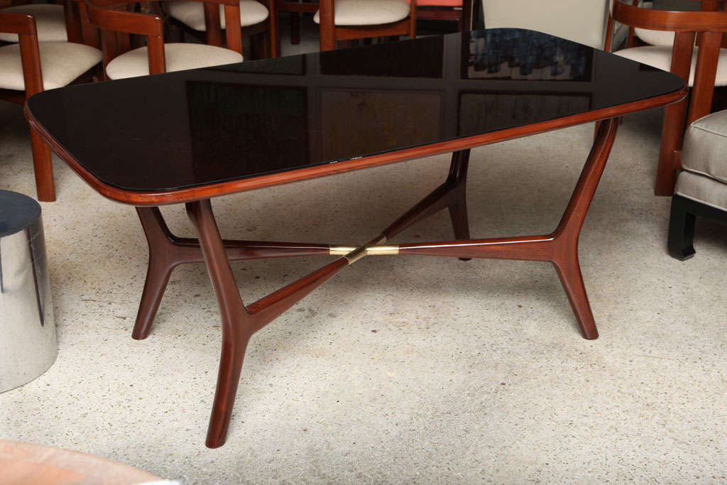 Dining Table For Sale The Rectangular Top With Rounded Edges Aboube Splayed Legs Joined By A Stretcher Brass An Italian Modern Mahogany