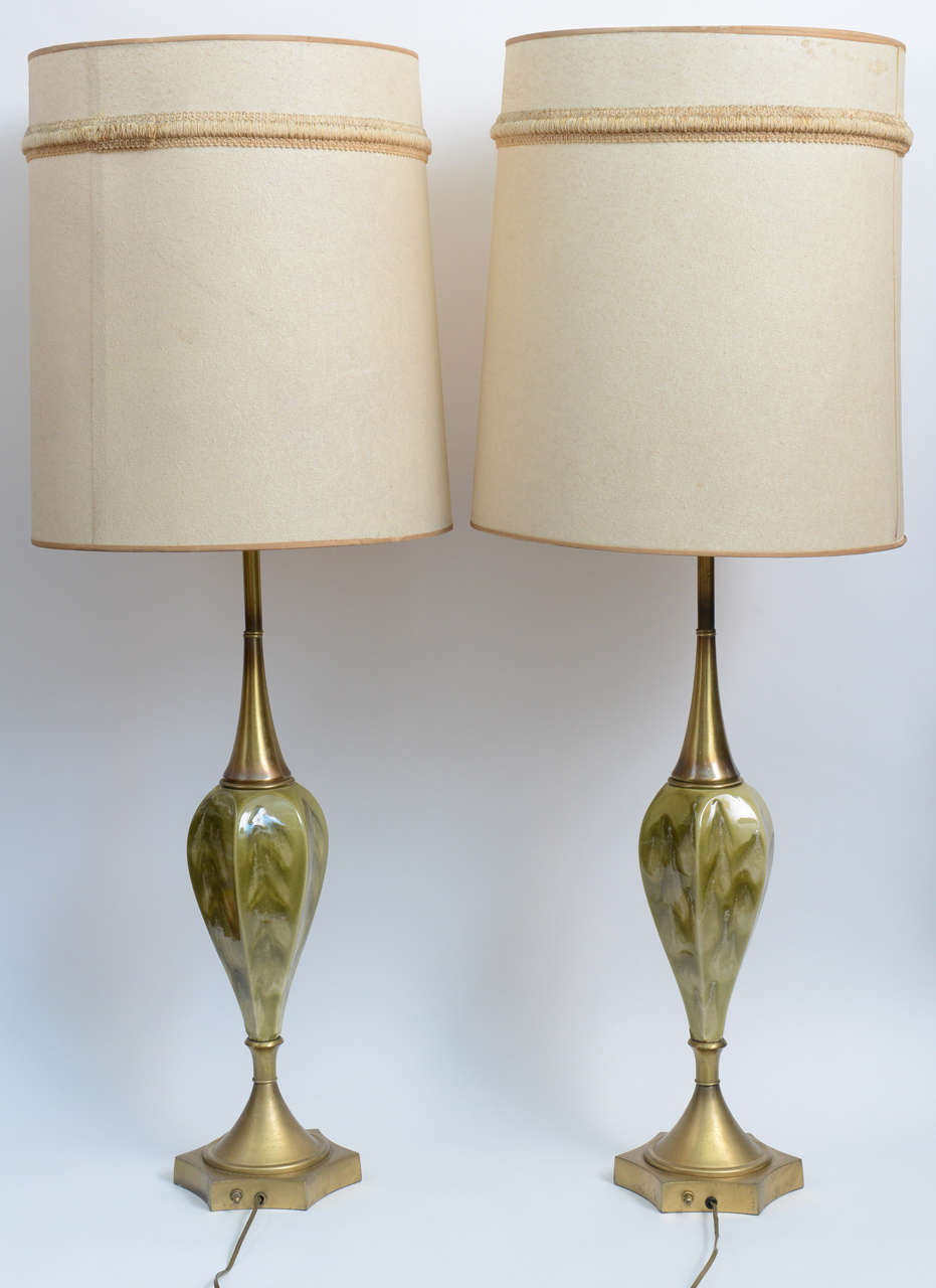 Those glamorous, chic and elegant lamps can add delicate opulence to your room. Green, gold and white swirls bedeck the ceramic hearts of the lamp, coupled with matte antique brass bases. Original embroidered shades adorn the lamps for additional