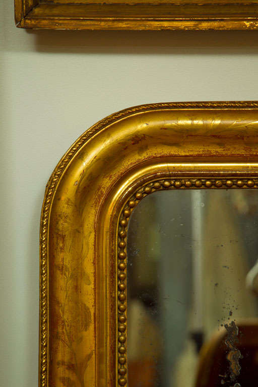 French Large Giltwood Louis Philippe Style Wall Mirror with Foliage Detail For Sale