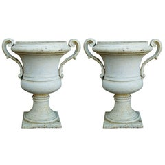 Pair of Painted Cast Iron Regency Urns with Volute Handles