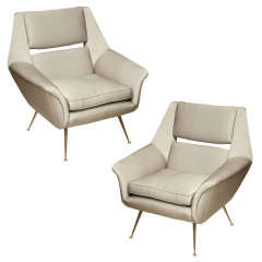 A pair of Carlo di Carli club chairs