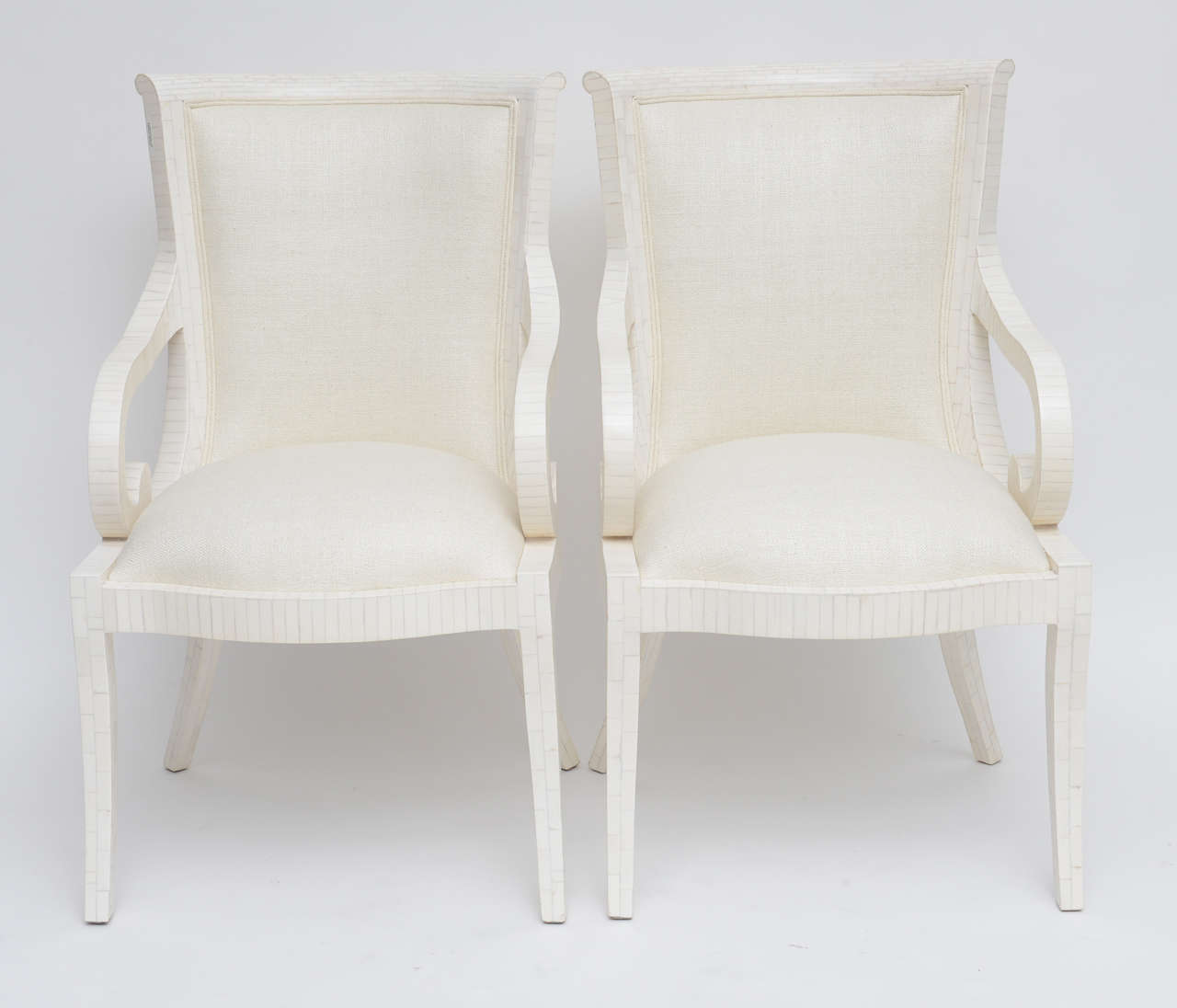 Immaculate, totally restored pair of tessellated bone armchairs by Enrique Garces, upholstered in a soft cream silk.
