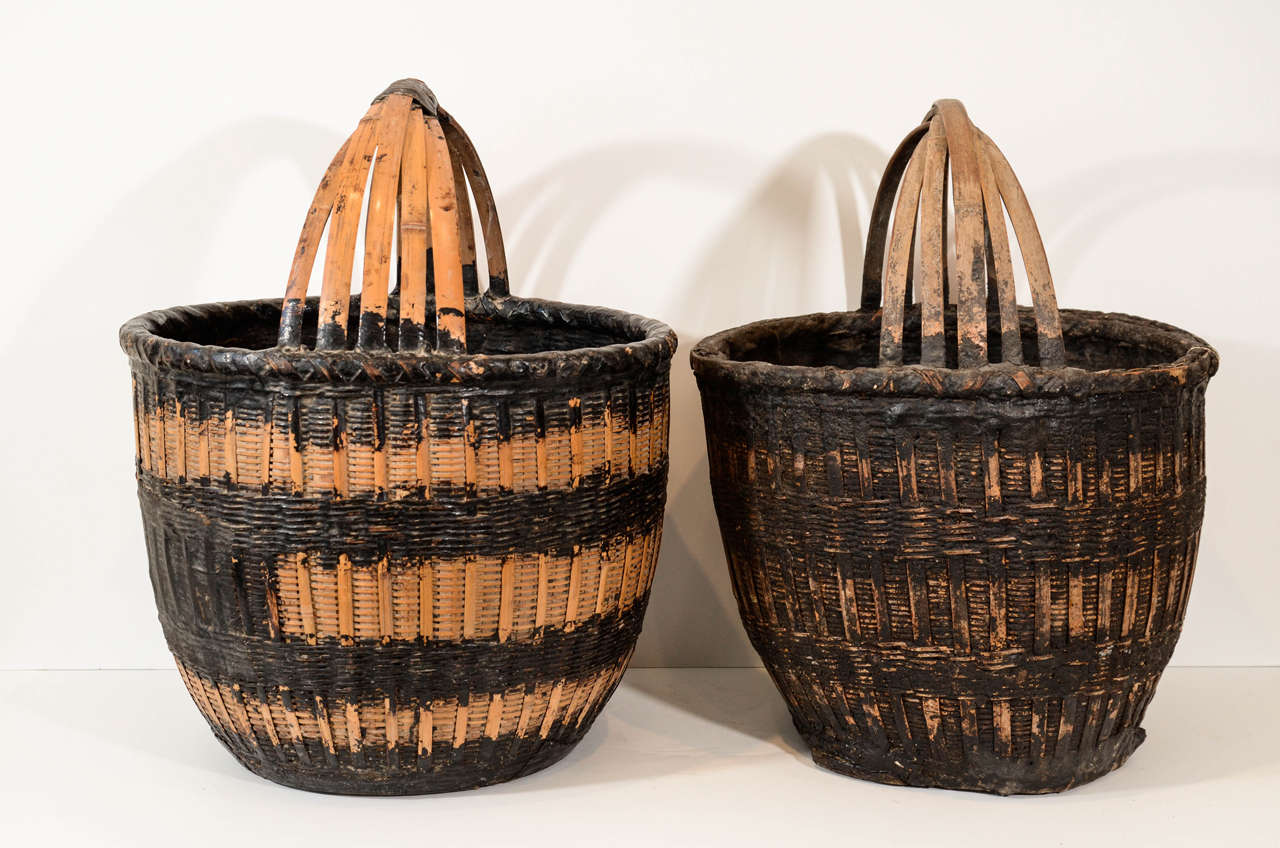 Antique Chinese woven willow food baskets, with striking natural black resin accents. From Shanxi Province, circa 1900. Priced individually, sizes and coloring vary. B429.