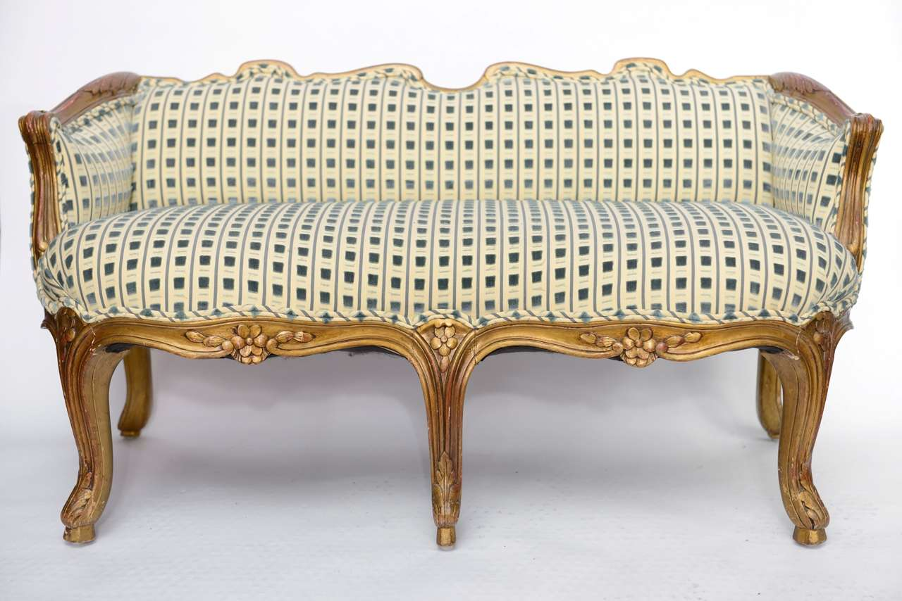 Charming child's sofa with hand-carved and gilded frame. Cut velvet and silk upholstery.