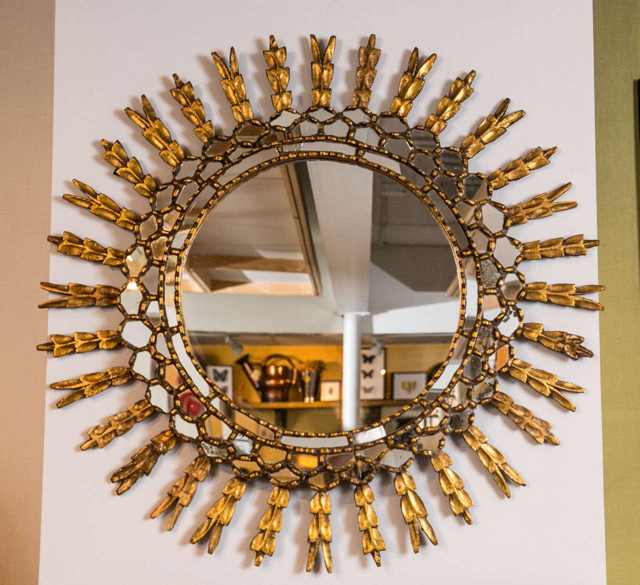 Giltwood sunburst mirror with tiered mirror border