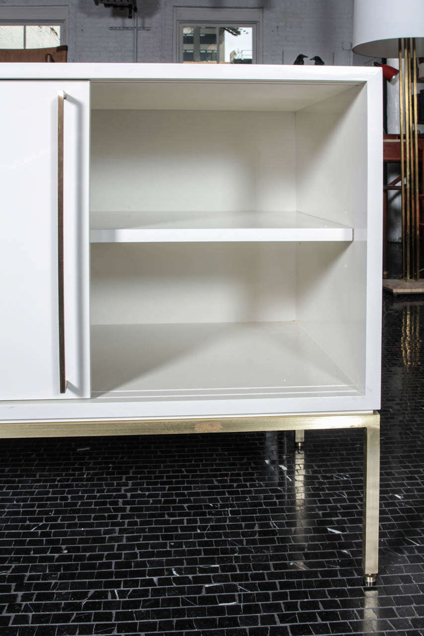 re: 379 credenza in soft chamois on satin brass frame In Excellent Condition For Sale In New York, NY